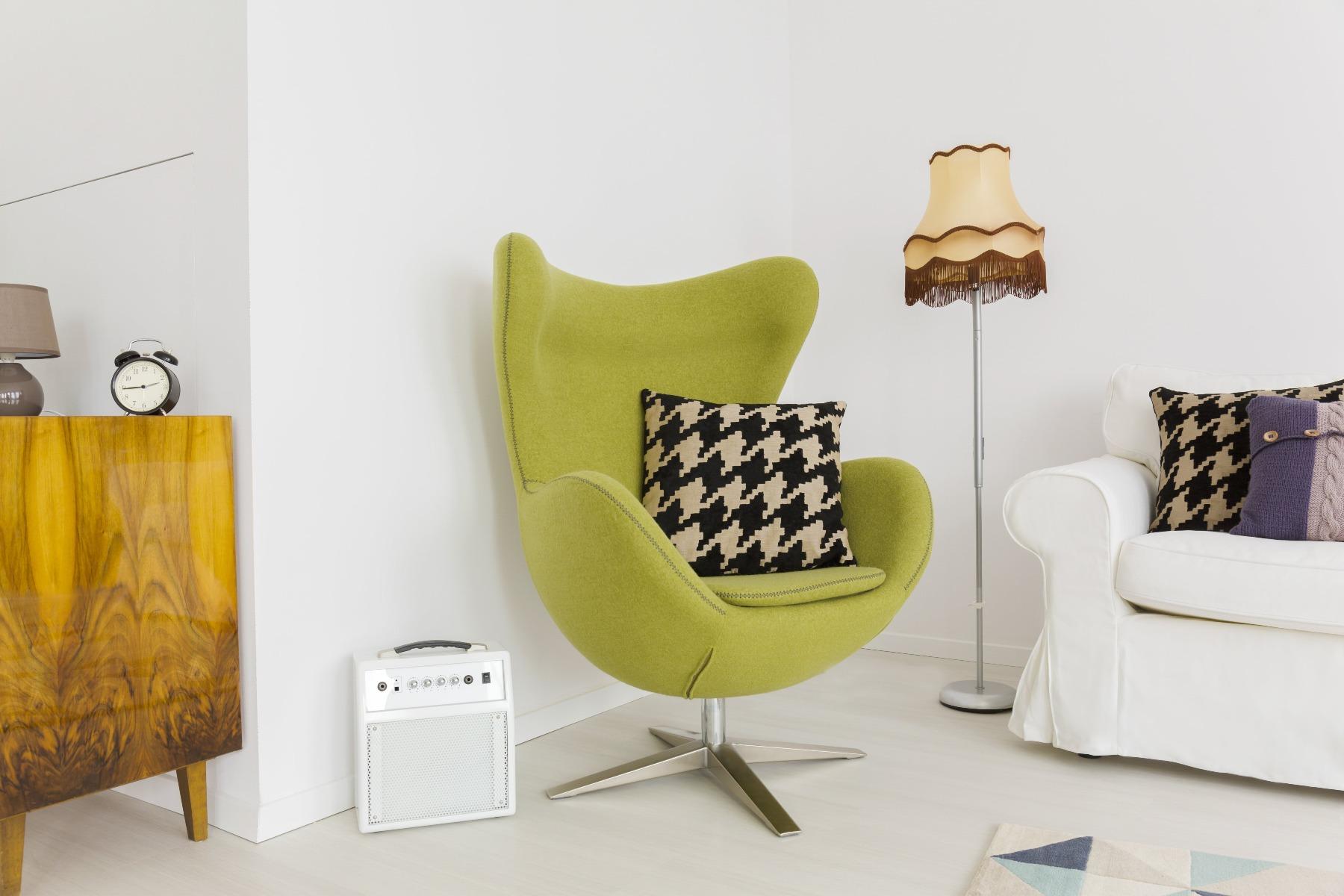 Das Bild zeigt einen Sessel im Vintage Stil.