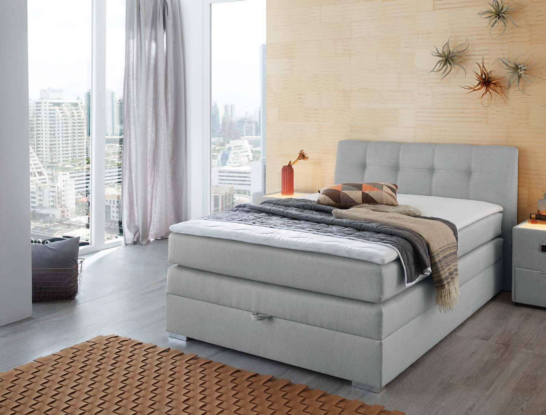 Das Bild zeigt ein Bett mit Boxspringfederung.