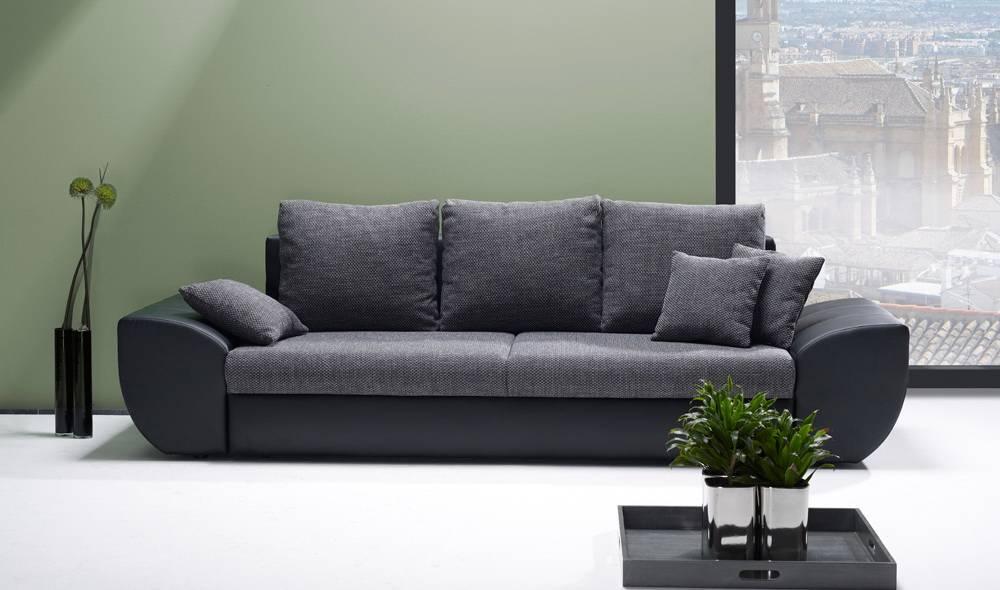 Das Bild zeigt ein 3-Sitzer Schlafsofa in Grau.